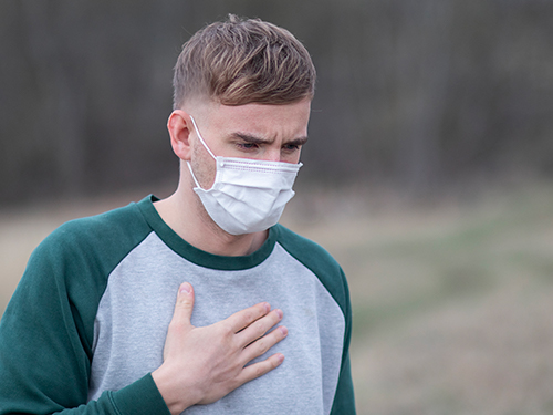 Man with mask has chest pain